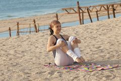 Young girl training on the beach Royalty Free Stock Photography