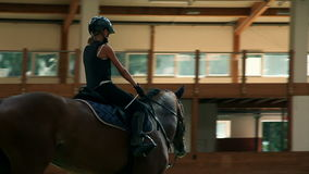 Young girl training for equestrianism stock footage
