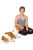 Young girl is training a jack russel. Isolated on white stock photo