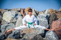 Young girl training karate Stock Photos