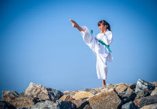 Young girl training karate Royalty Free Stock Photos