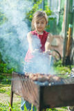 Young girl trains kebab Stock Images