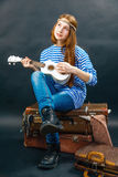 Young girl is travel-ling. A young girl is travel-ling with her guitar Royalty Free Stock Image