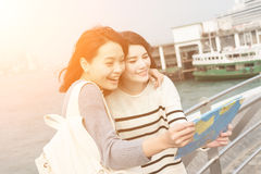 Young girl travel and look the map Stock Photography