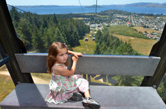 Young girl travel on Skyline Gondola Royalty Free Stock Images