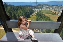 Young girl travel on Skyline Gondola Royalty Free Stock Images