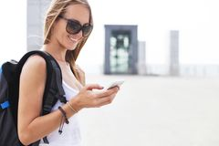 Young girl traveler with backpack looking on phone Stock Photo