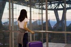 Woman traveler using mobile smartphone airport stock photos