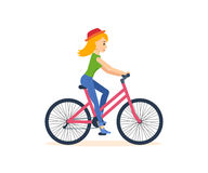 Young girl traveling by bicycle, is engaged in outdoor activities. Royalty Free Stock Photo