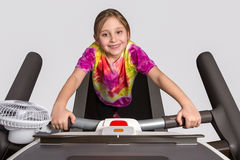 Young Girl on Treadmill Royalty Free Stock Photo