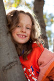 Young girl in tree Stock Image