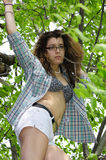 Young Girl in Tree Shirt open. Young girl with shirt open and bikini top underneath up in a tree Stock Photos