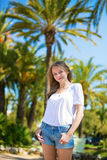 Young girl on a tropical resort Stock Image