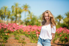 Young girl on a tropical resort Stock Images