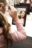 Young girl trying on glasses Stock Image