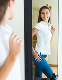 Young girl trying on a t-shirt Royalty Free Stock Photography