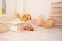 Young girl trying to keep calm and relax during the relocation. Stock Photos