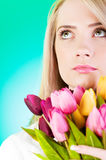 Young girl with tulips Stock Photography