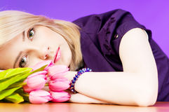 Young girl with tulips Stock Images