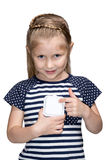 Young girl turning off light switch Stock Photo