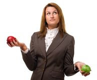 Young girl with two apples. Studio shot over white background Royalty Free Stock Photography