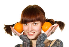 Young girl with two oranges Stock Photo