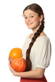 Young girl with two pumpkins Royalty Free Stock Image