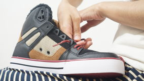 Young girl tying her brand new sneakers Stock Photos