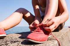 Young girl tying shoelace. Royalty Free Stock Photography