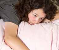 Young Girl Tying to Wake up in the Morning Stock Images