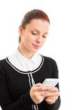 Young girl typing on her phone Royalty Free Stock Images