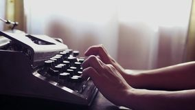 A young girl is typing on an old typewriter. Slow Motion. 1920x1080. HD stock video
