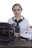 Young girl typist Stock Images