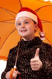Young girl with umbrella Stock Image