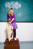 Young girl with umbrella indoors Stock Photo