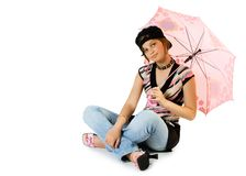 Young girl with umbrella sits. On floor. Isolate on white Royalty Free Stock Photo