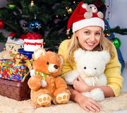 Young girl is under the Christmas tree Stock Image