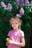 Young girl under lilac Stock Photos