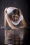Young girl under rain. Young caucasian brunette girl under rain Royalty Free Stock Image