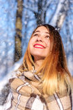 Young girl under snowing Stock Photography