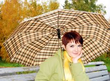 The young girl under an umbrella. Stock Photo