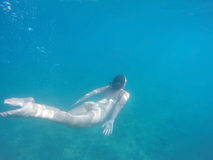 Young girl underwater Stock Photography
