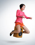 Young girl unreal flies on speaker. Young beautiful girl unreal flies on speaker, motorcycle stylize concept Stock Images