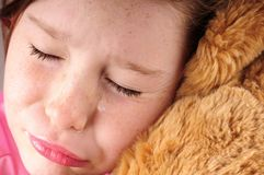 Young girl upset with bear Royalty Free Stock Photos