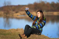 Young girl use her mobile for making photo Royalty Free Stock Photography