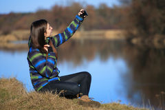 Young girl use her mobile for making photo Stock Image