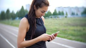 Young girl use sport app and hold her phone stock photos