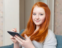 Young girl uses e-book Stock Images
