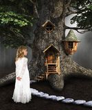 Children Play, Imagination, Make Believe. A young girl uses her imagination to pretends she is a forest princess who live in a tree in the woods. Abstract stock images