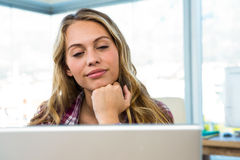 Young girl uses his computer Royalty Free Stock Photography